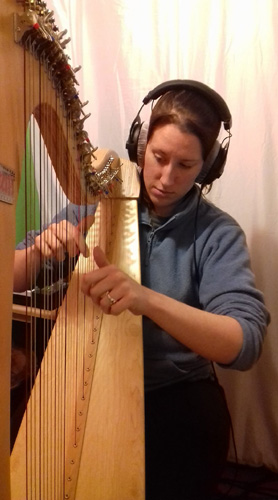 Chantelle playing her harp as part of the recording process for her EP